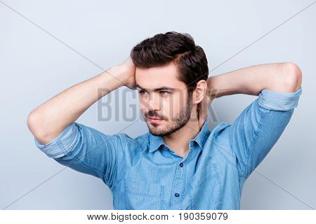 Close Up Portrait Of Confident Brunet Man Touching His Head And Neck. He Is Playful And Flirty