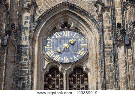 14th century St. Vitus Cathedral facade clock Prague Czech Republic. Cathedral is a Roman Catholic metropolitan cathedral in Prague the seat of the Archbishop of Prague.