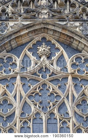 14th century St. Vitus Cathedral facade window with stained glass Prague Czech Republic. It is a Roman Catholic metropolitan cathedral in Prague the seat of the Archbishop of Prague.