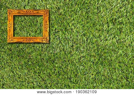 picture frame on artificial grass field background