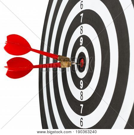 dartboard with darts isolated on white .