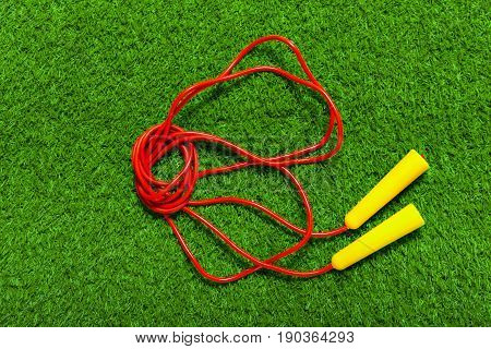 Jump ropes on grass. top view .