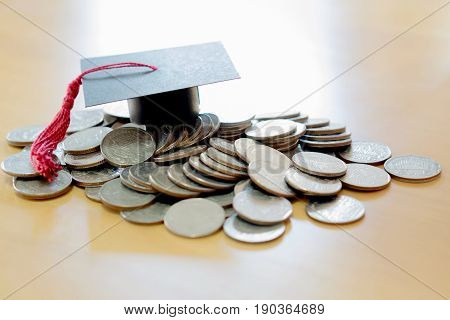 Saving for education, currency, money, coins, graduation