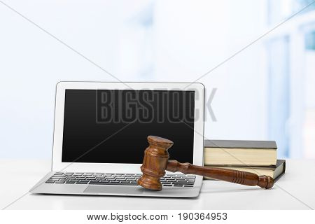 Laptop And Mallet On Table . close up