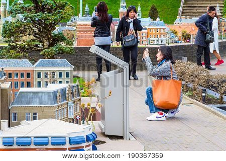 Hague, Netherlands - April 8, 2016: People at Madurodam, Holland park and tourist attraction in Hague, Netherlands