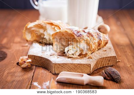 fresh crust croissant with milk on wooden plate