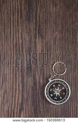 Compass On A Wooden Table