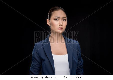 Portrait Of Serious Businesswoman In Formalwear Looking At Camera Isolated On Black