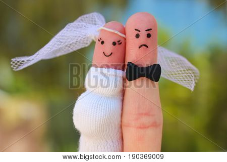 Fingers art of couple. Concept of shotgun wedding. Man was upset because woman is pregnant and he needs to get married.