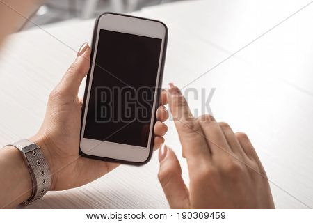 Cropped Shot Of Woman Holding Smartphone With Blank Screen