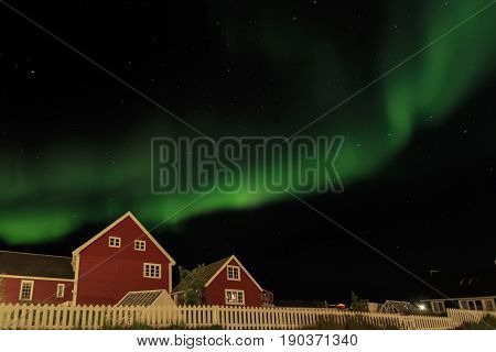 Northern Lights And Starlight Sky Over Two Red Living Houses, Nuuk, Greenland