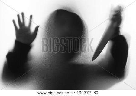 Shadow Blur Of Horror Man In Jacket With Hood Hold The Knife To Stabbed And Right Hand Touches The G