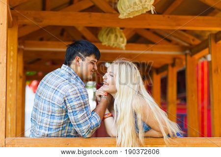 Beautiful couple doing arm wrestling challenge outdoors