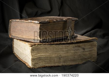 Old Books On Black Background. Ancient Christian Bible. Antique Holy Scripture Books. Pile Of Books