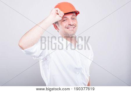 Portrait Of Contractor Posing Holding His Orange Hardhat