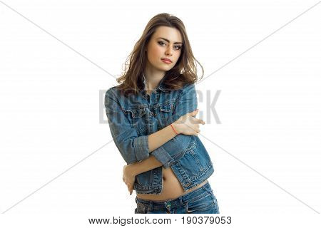 charming young girl poses on cam in jeans dress close-up isolated on white background