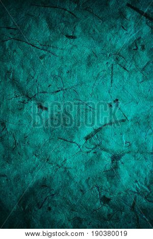 Abstract turquoise texture and background for designers. Vintage paper background. Rough turquoise texture of recycled paper. Closeup view of abstract turquoise texture. Vintage blue paper.
