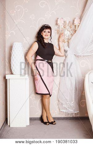 Portrait of attractive brown-haired women indoors