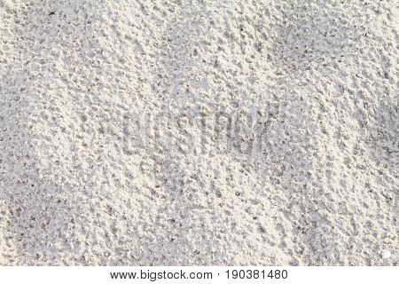 Top view of sand pattern of a beach, background with copy space and visible sand texture
