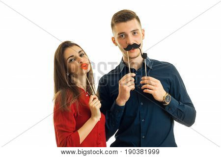 cheerful young couple has fun with a sham isolated on white background
