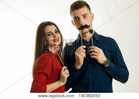 a charming young couple having fun with a sham isolated on white background