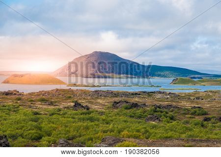 Sunset time in volcanic landscape at Myvatn Lake, aka Lake of mosquitos, northern Iceland.