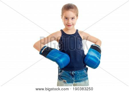 portrait of little girl in blue boxing gloves isolated on white background