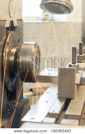 End milling with horizontal side mill machine. Metalworking mechanical engineering lathe and milling technology. Indoors vertical image.