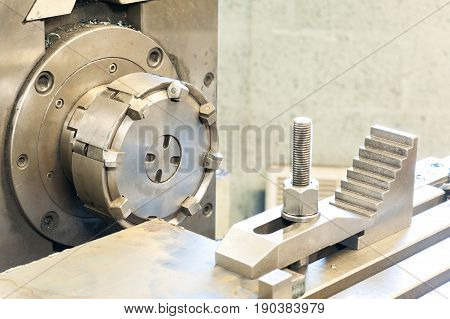 End milling with horizontal side mill machine. Metalworking mechanical engineering lathe and milling technology. Indoors horizontal image.