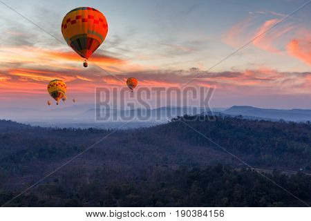Colorful hot air balloons flying over mountain at Pakse Laos