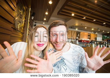 Funny playful young couple making silly face.