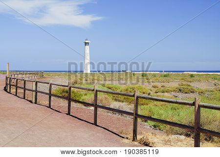 View on the lighthouse and coast of the Atlantic ocean in Morro Jable on the Canary Island Fuerteventura Spain.