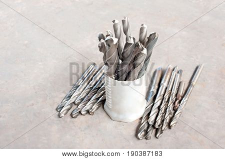 Many metal drill bits. Drilling and milling industry. Closeup.