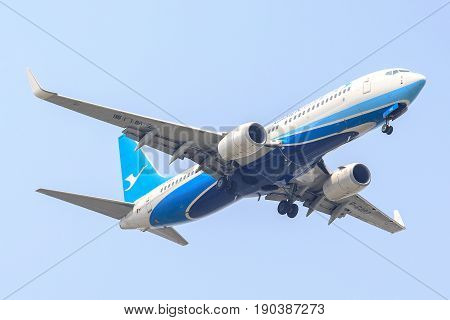 Bangkok, Thailand. - April 22, 2017 : Aircraft or Plane of Xiamen Airlines or Airways on the sky landing to Suvanabhumi airport.