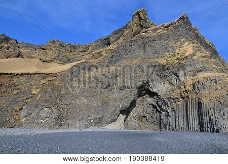 Blue skies over the basalt columns found on the black sand beach in Vik Iceland.