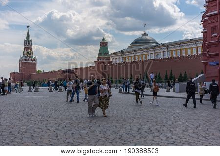RUSSIA MOSCOW JUNE 8 2017: Undefined people walk on the Red Square in Moscow. Moscow Kremlin
