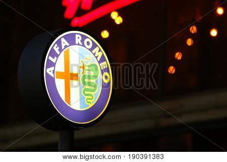 Bangkok, Thailand - 23 January 2016 : Alfa Romeo Sign at night background.