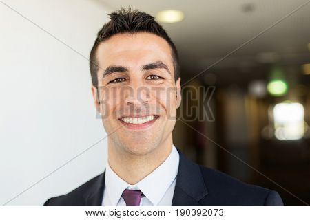 business and people concept - businessman in suit at corridor in hotel