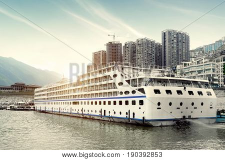A large cruise ship docked in the Yangtze River Chongqing China.