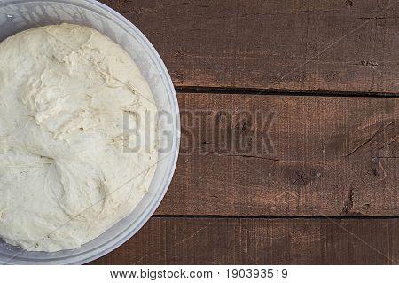 Kneading dough, fermented dough in a basin, dough for making bread