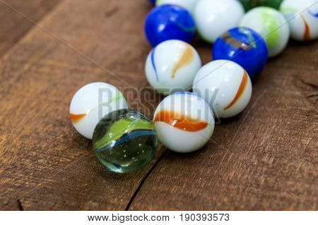 Children's games, playing marbles, various colored marble paintings,