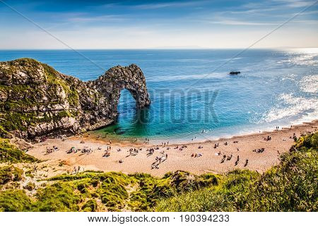 british seaside - summer holiday destination - Durdle Door at the beach on the Jurassic Coast of Dorset, UK