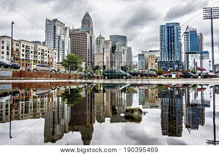 Reflecting Charlotte North Carolina Skyline In The Puddle After Rain Storm