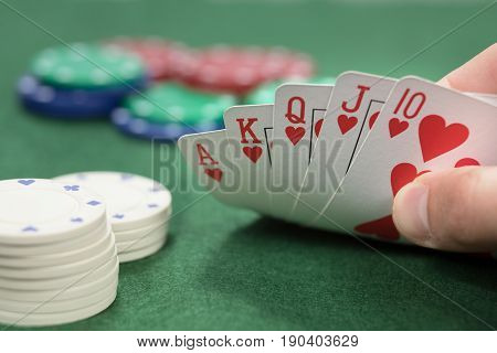 Poker Player Checking His Royal Straight Flush