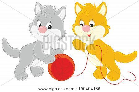 Little kittens playing with a red clew of yarn