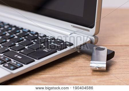 Flash Drive Attached To A Laptop Computer