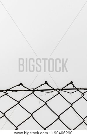 chain link fence in front of a white background