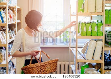 Woman Choosing Products In Ecological Shop