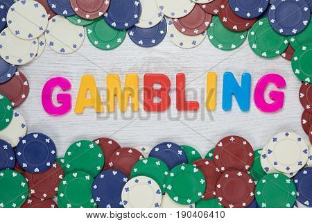 Conceptual Image Of Gambling With Colorful Text