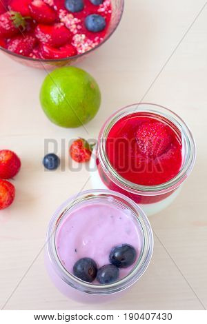 Strawberry fruit smoothies with fresh strawberries and yogurt with blueberries.
